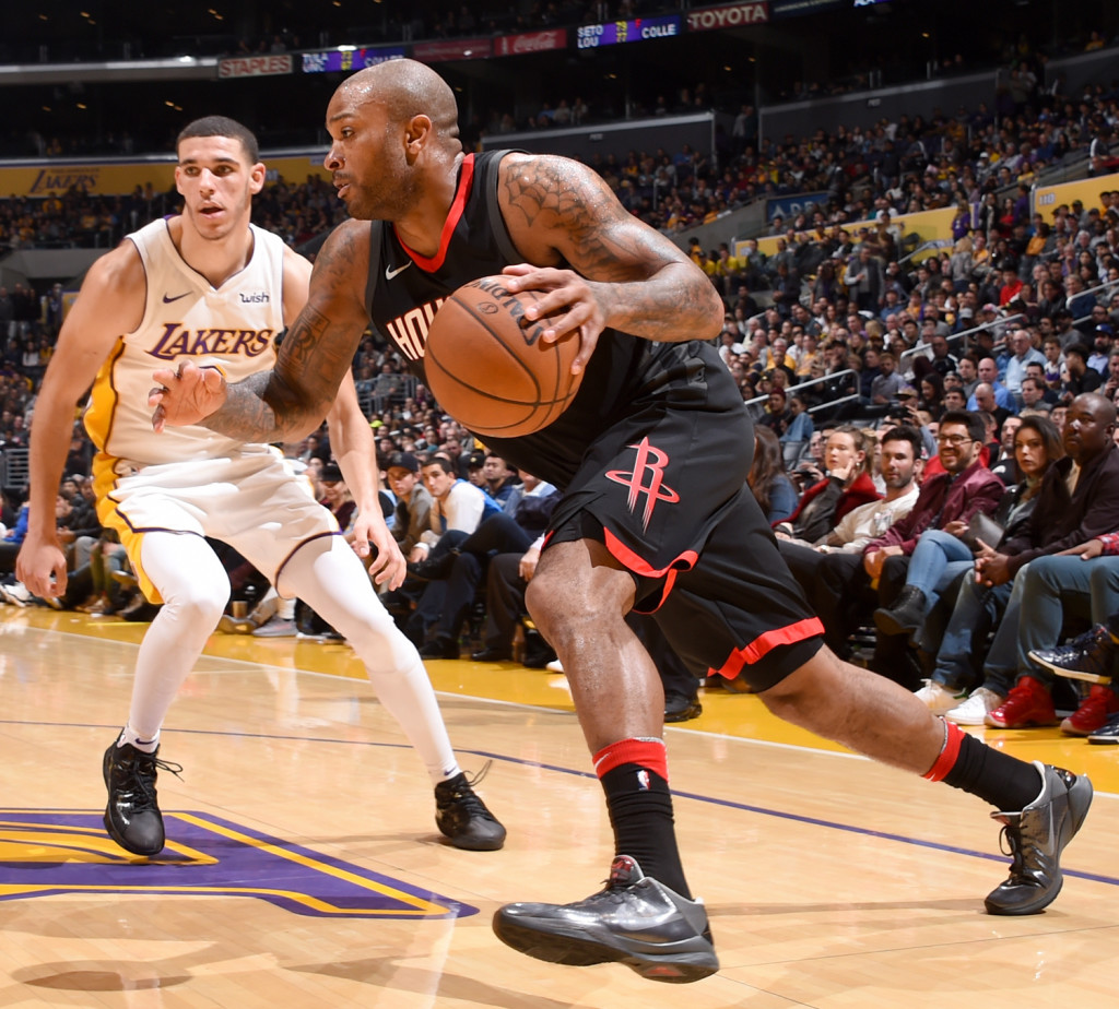 LOS ANGELES, CA - DECEMBER 3: Eric Gordon #10 of the Houston Rockets drives to the basket against the Los Angeles Lakers on December 3, 2017 at STAPLES Center in Los Angeles, California. NOTE TO USER: User expressly acknowledges and agrees that, by downloading and or using this photograph, user is consenting to the terms and conditions of the Getty Images License Agreement. Mandatory Copyright Notice: Copyright 2017 NBAE (Photo by Adam Pantozzi/NBAE via Getty Images)